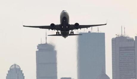Plane take-offs from Logan Airport are viewed from a residential neighborhood.